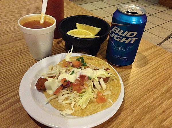 What $2.69 buys: a Bud Light, fish taco, and free fish soup