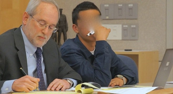 The judge ordered the face of defendant Salazar to be obscured (defense attorney Jeff Martin on left).