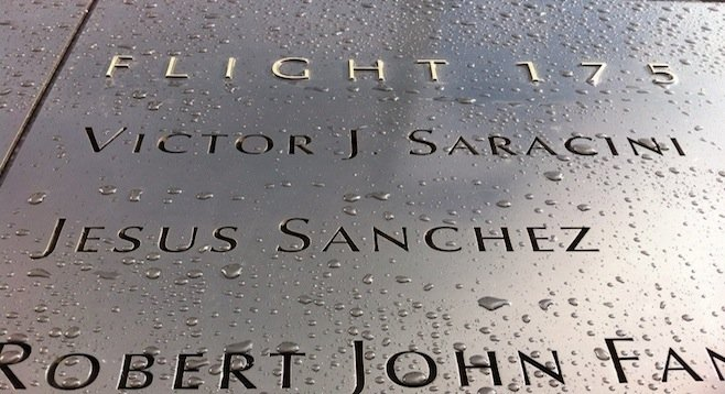 9/11 victims' names are engraved next to the memorial's twin reflecting pools.