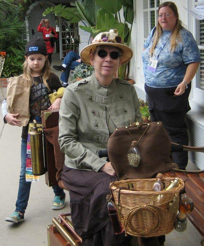 Great steampunk wheelchair, especially the brass thermos!  Caption by Jay Allen Sanford