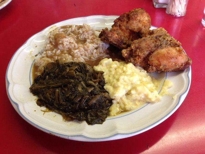 Heaping plate of fried chicken, collard greens, potato salad and gravy rice. I actually ate more than this. Sister Pee Wee's Soul Food.
