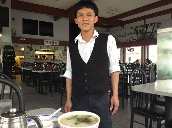 Cuong coaches Bedford on his porridge seasoning.