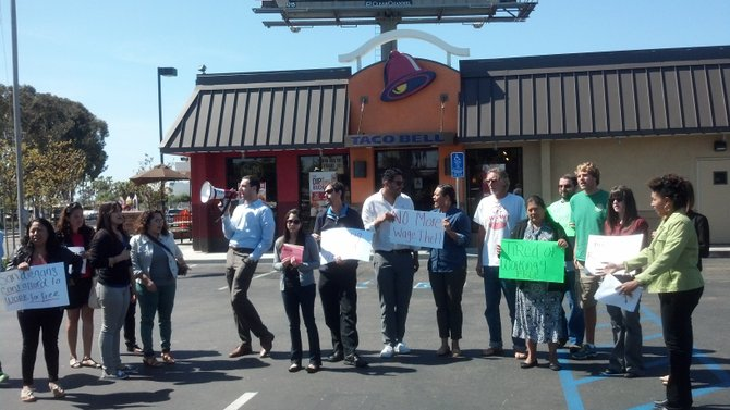 Food workers and supporters rally outside KFC/Taco Bell on Clairemont Mesa Boulevard
