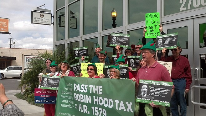 """Robin Hood Tax"" advocates outside Susan Davis' office"