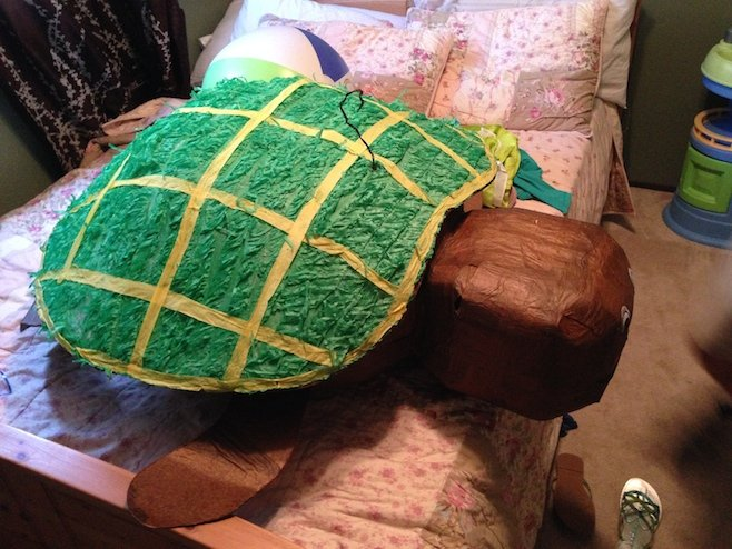 Gigantic turtle on a twin (er, full) bed.