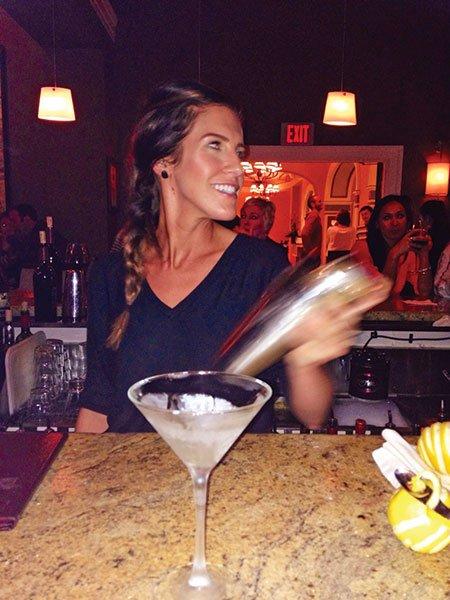 Sarah Lemke, pouring the Nine-Ten's Martinez.
