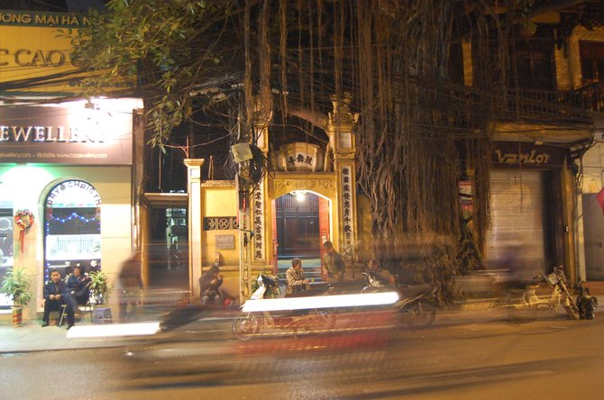 Night time street in the Hoan Kiem District of Hanoi, Vietnam.