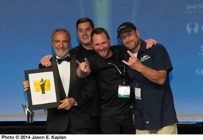 Coronado Brewing Company's staff accept a gold medal for Islander IPA from Brewers Association president Charlie Papazian at the 2014 World Beer Cup in Denver, Colorado. - Image by Jason E. Kaplan