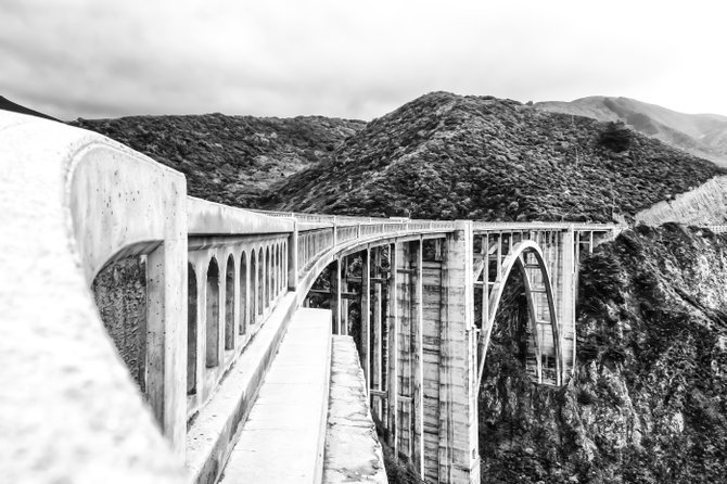Bixby Creek Bridge on the State Route 1. I recently took a trip to Monterey, Ca and decided to drive the Pacific Coast Highway the entire way back to San Diego.   I simply loved the curve and structure of the bridge and felt like highlighting that in my photo vs featuring the cost/beach as I have seen many other times.   Bixby Creek Bridge Big Sur, Ca USA