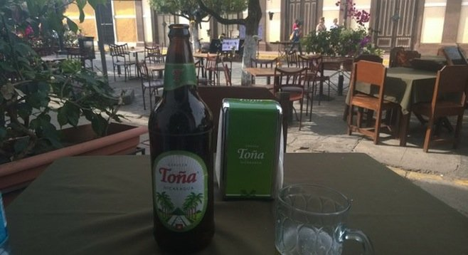 Enjoying a (cheap) Toña on Granada's Calle La Calzada.