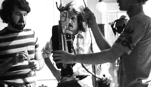 Dean Cundey (l) and John Carpenter (center) on the set of Halloween