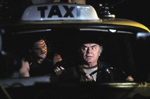 Kurt Russell and Ernest Borgnine in Escape From New York. Lighting by Cundey.