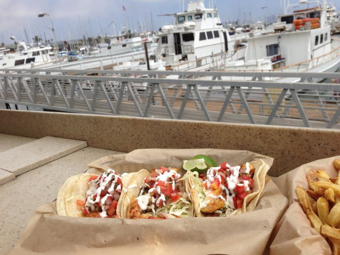 A variety of fish tacos. Shrimp and halibut tacos. Mitch's Seafood.