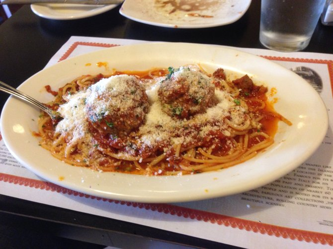 If you don't say stop, the Parmesan piles up. Spaghetti and meatballs. Mamma Teresa.