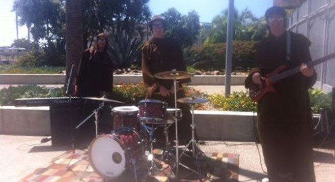The friar-disguised Wheeler brothers busking outside the ballpark