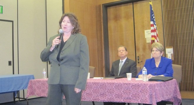 Teri Wyatt has the floor (seated: Bob Brewer, Bonnie Dumanis)
