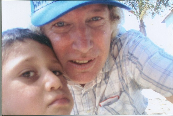 The author and one of the kids take a selfie.