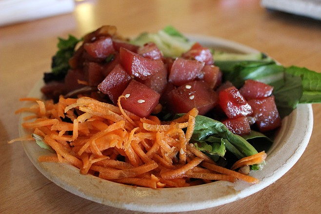 The Ahi Poke comes with an optional drizzle of wasabi aioli for an added kick.