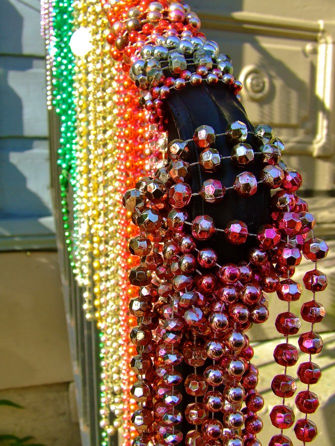 Let the good times roll in New Orleans!  Bright beads line a handrail in The Big Easy.