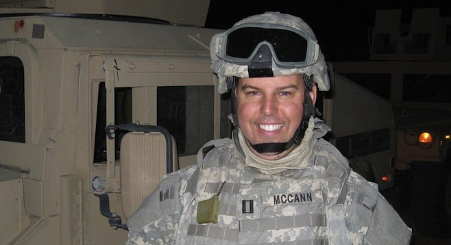 John McCann served a year in Afghanistan as a naval reservist.