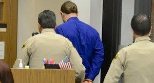 Tim taken away in cuffs. Photo Weatherston