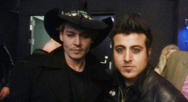 Photo op! Johnny Depp, Johnny Depp's large hat, and Chris Leyva.