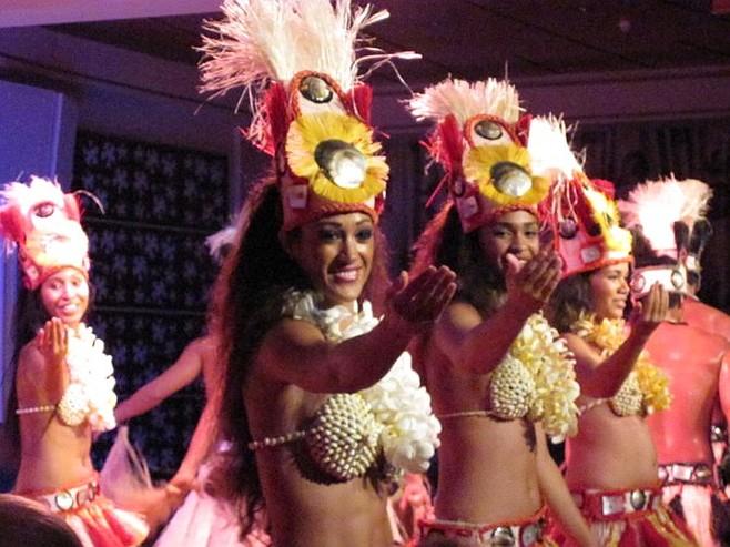 Traditional Polynesian dancers perform.