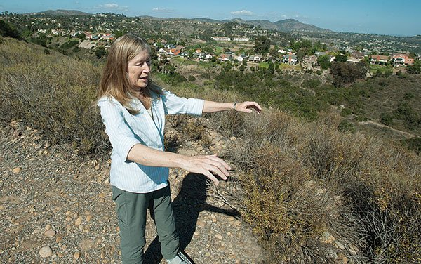 Jennifer Cochrane Schultz is one of a few residents blowing the whistle on illegal trail construction.