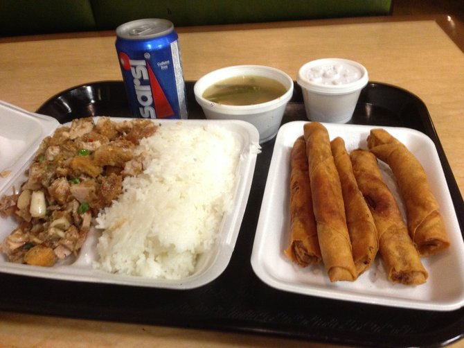 Eight dollars gets you a lot of food, considering there's about three bucks worth of styrofoam on there. Sisig and lumpia. Tita's II.