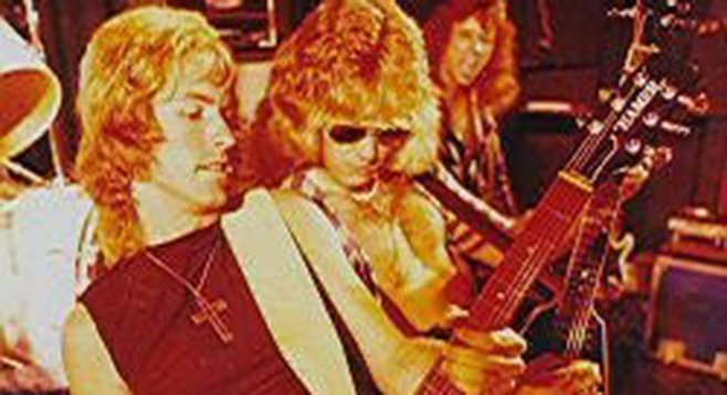 Ronny Jones (front) rocking out back in the day with Ratt's Robbin Crosby.