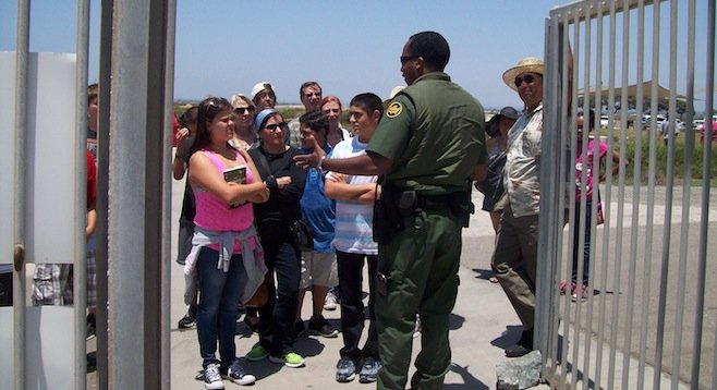 Border Patrol agent Kris Stricklin explaining to people that they cannot come in until someone else leaves