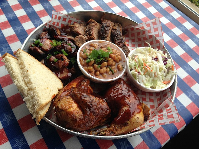 Pig Out Platter at Lil' Piggy's Bar-B-Q: Brisket, sausage and chicken, beans and cole slaw
