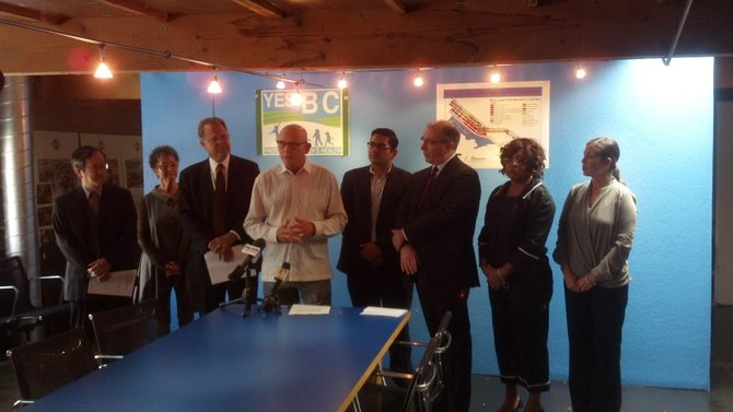 Mark Steele (center) flanked by business community supporters of Barrio Logan community plan update