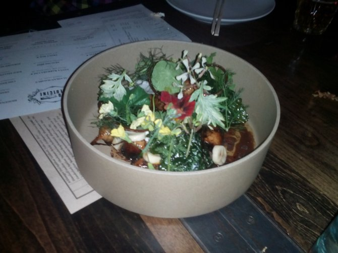 Baked Fried Turnips with Goat cheese garnished with bitter Flowers and Herbs.