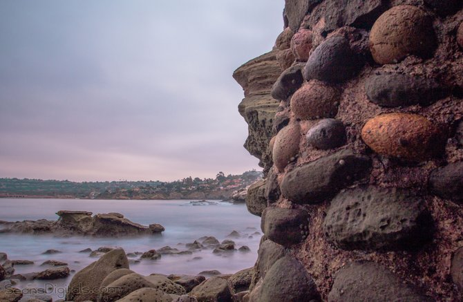 A cool morning in La Jolla, watching the waves crash along the rocks. Looking out from the small cave near the beach.