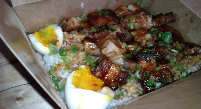 Pork belly adobo with fried rice and soft-boiled eggs at L.A.'s Oi Asian Fusion.