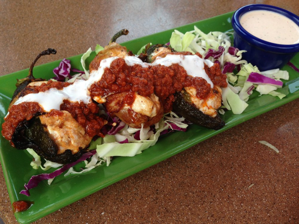 Bacon-wrapped, cheese stuffed jalapeño peppers at Casa Sol y Mar
