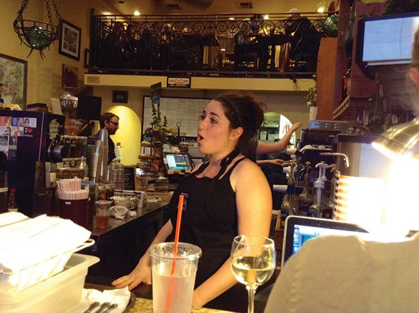 Julie sings an aria from behind the counter