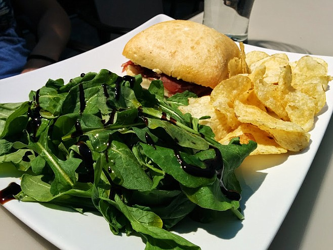 Sandwich with arugula salad on the side