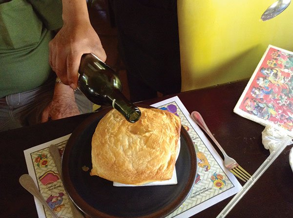 Al's lobster bisque, covered in puff pastry, gets a jigger-full of sherry.