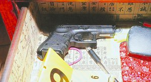 Glock in Upton's drawer. Evidence photo.