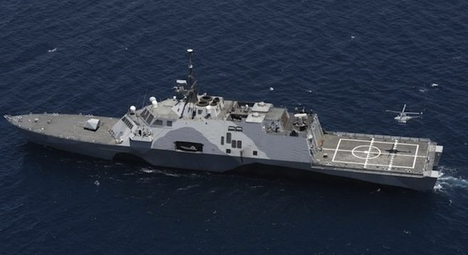 Fire Scout drone copter taking off from the USS Freedom