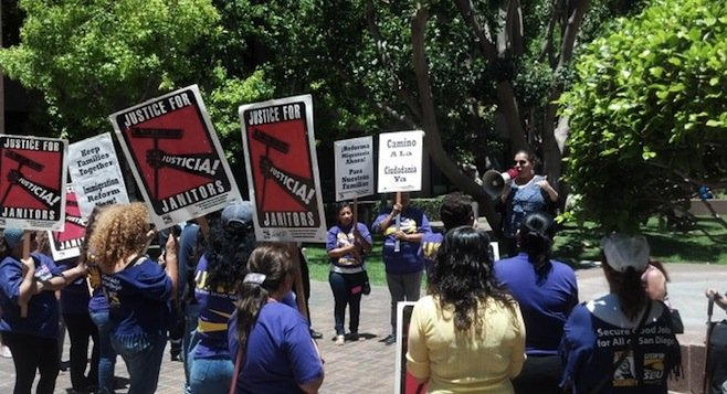 Genoveva Aguilar addressed service-industry workers at a June 13 immigration rally