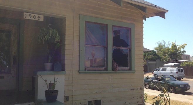 Windows were reportedly broken by flash grenades.