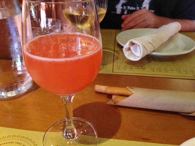 Rossini (strawberry, St. Germain, prosecco) and breadsticks.