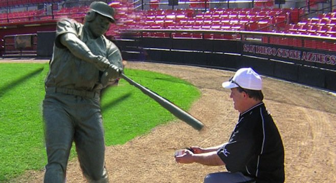 Tony Gwynn statue consults with SDSU batting coach Slappy Smith on proper form.