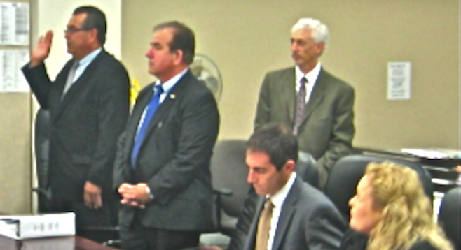 Greg Sandoval (far left) swore to tell the truth before pleading guilty on April 4.