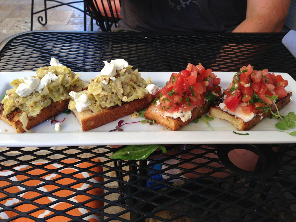 Tomato-basil crostini; goat cheese, artichoke-lemon crostini at Hanna's Gourmet