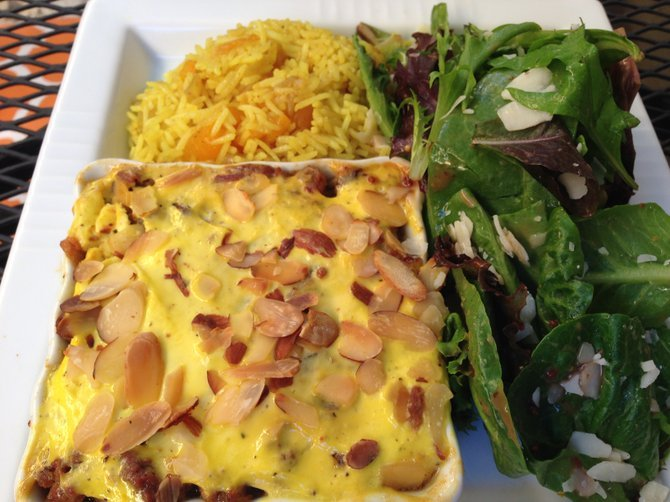 South African curried meatloaf with yogurt egg sauce, yellow rice and arugula salad at Hanna's Gourmet