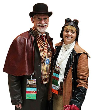 Married couple David Drake and Katherine Morse co-write adventure stories set in the Victorian era.